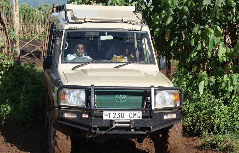 Driving safarivehicle with a private safari group inside