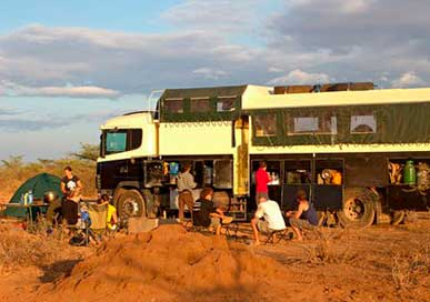 Camp of safari group in front of their bus